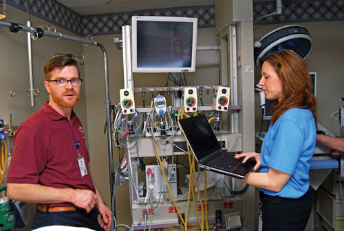 Daryl Lehmann and Angie Jowanowitch verify that Spacelabs data is being captured on Cerner's iBus.