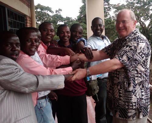 Billy Teninty with students in Rwanda.