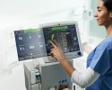 Photo of clinician operating Carescape R860 ventilator. Photo courtesy GE Healthcare.