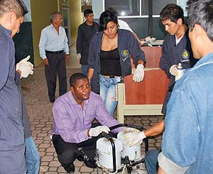 In the Pastaza Province at the Puyo General Hospital in Ecuador, Eben Amstrong (center) of MedShare leads practical repair sessions.